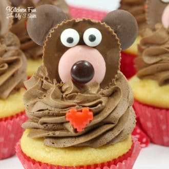These Valentine Bear Cupcakes are so adorable! The cute little bear on top of these yummy french vanilla cupcakes are made from everyone's favorite sweet treat: Reese's cups!