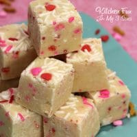This Valentine's Day cake batter fudge recipe full of pink and red sprinkles tastes like a mini vanilla cake!