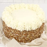 This Carrot Cake Cheesecake Cake recipe is layered with moist cake, cream cheese frosting and cheesecake. This is the best way to make a carrot cake!