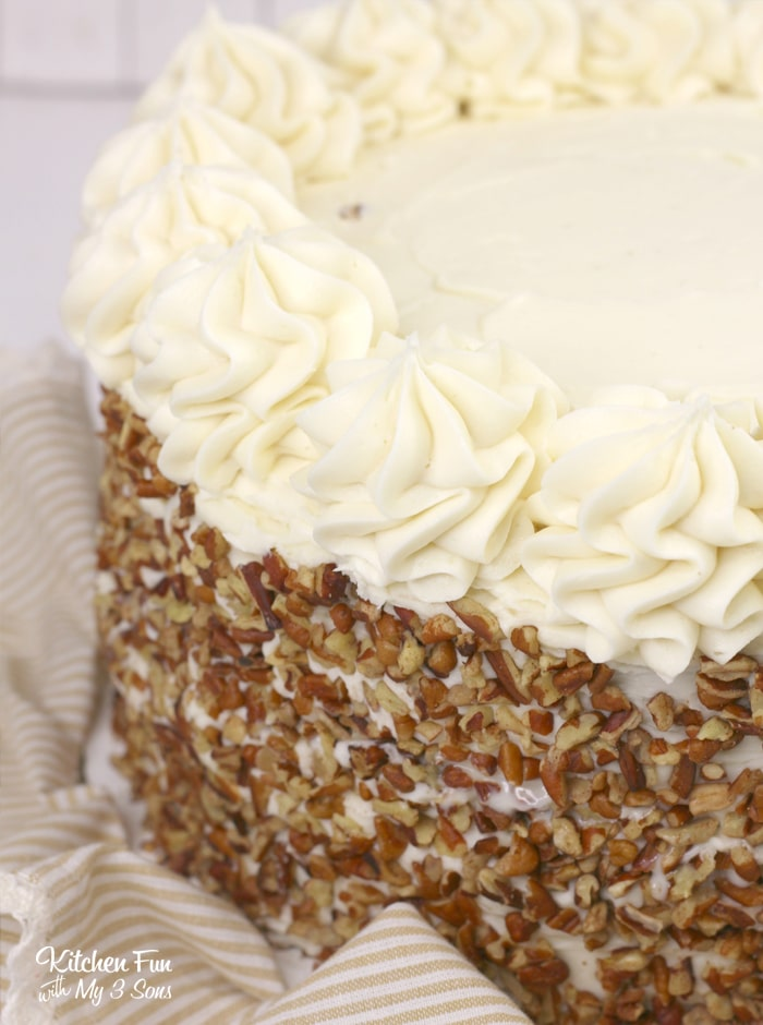 This Carrot Cake recipe is layered with moist cake, cream cheese frosting and cheesecake. This is the best way to make a carrot cake!