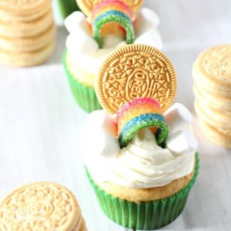 These Easy St. Patrick's Day Cupcakes are the cutest things ever. Add a golden Oreo, marshmallows and rainbow candy to make a simple and yummy holiday treat.