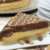 This Peanut Butter Pie recipe is inspired by our love of the Tagalong Girl Scout cookies. With one thick layer of peanut butter and one layer of delicious chocolate ganache, you will love this dessert!