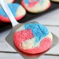 Patriotic Cake Mix Cookies are a swirl of red, white and blue that's perfect for the 4th of July. They're an easy cookie recipe that always taste yummy.