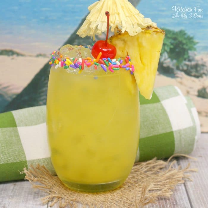 A Cake by the Ocean Cocktail is the perfect beach drink this summer. It's full of tropical flavors including pineapple and orange juice, coconut rum and yes, cake flavored vodka!