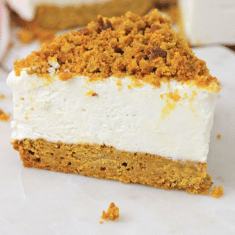 Slice of no bake cheesecake with pumpkin bread crust sitting on a white surface