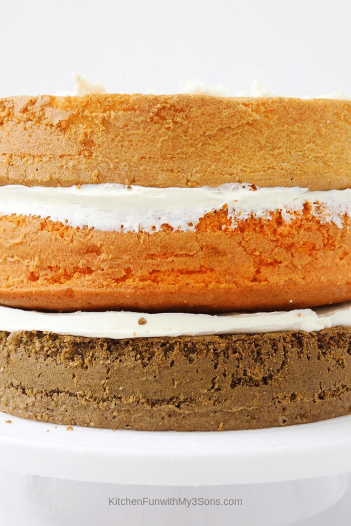 The 3 layers of cake for the pumpkin spice latte cake being prepared on a cake stand