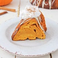 A slice of pumpkin spice angel food cake on a white plate