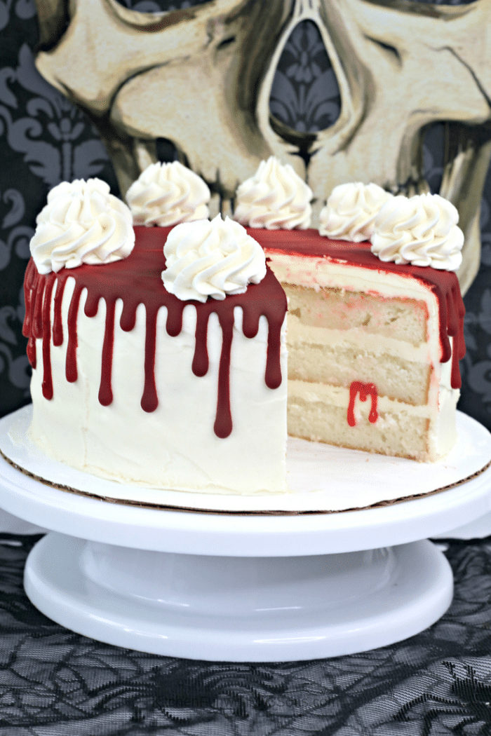 Collage image of slices of vampire blood cake on a white cake stand