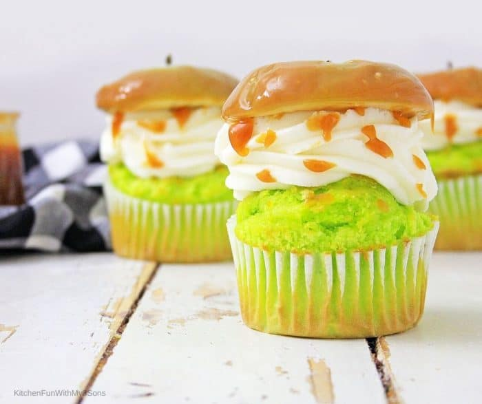 Caramel apple cupcakes on a wooden table ready to be served