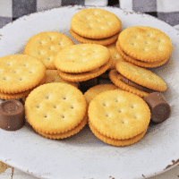 White platter filled with rolo stuffed ritz cracker candy