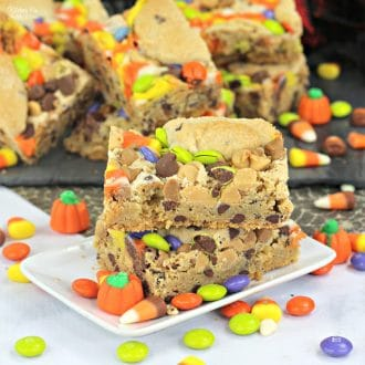 Leftover Halloween Candy Cookie Bars is the best way to do something fun with that huge bag of chocolates you just collected.