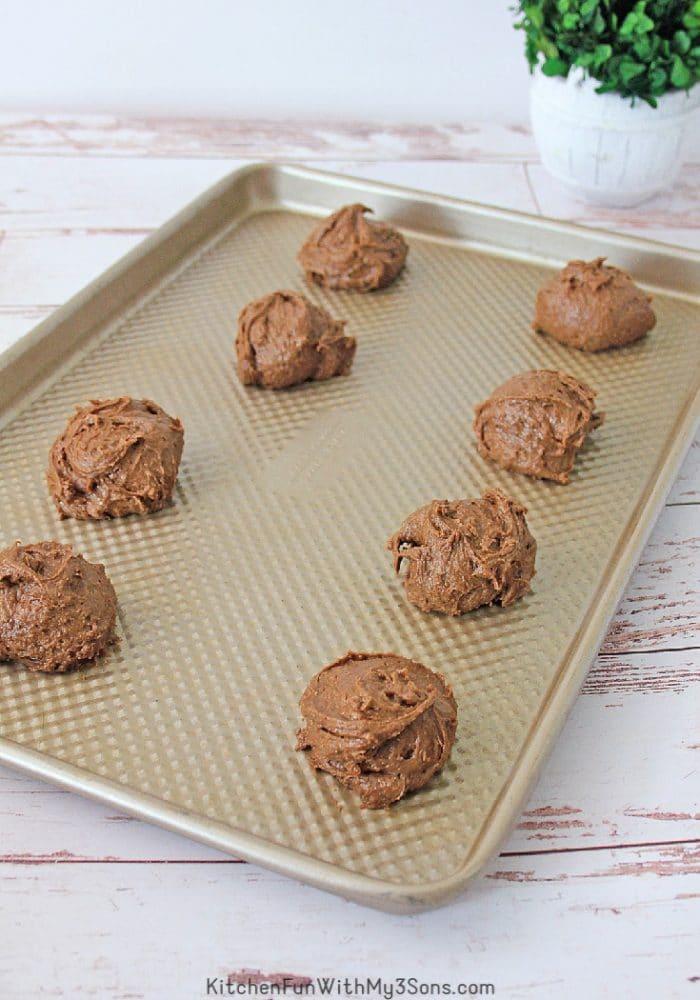 Brownie batter cookies on baking sheet