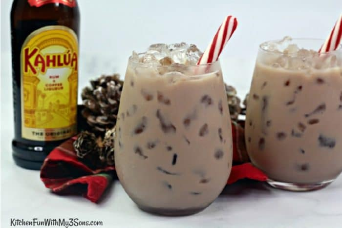 Chocolate White Russian in short glasses with a bottle of Kahlua in background