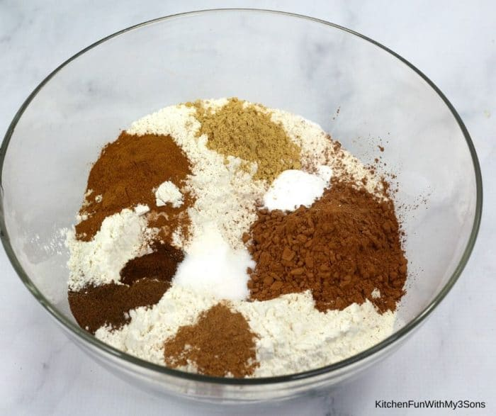 Ingredients for gingerbread cookies in a large bowl