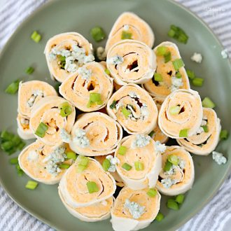 Buffalo Chicken Roll Ups with cream cheese, shredded chicken and buffalo sauce are a spicy appetizer to serve up at your next get-together.