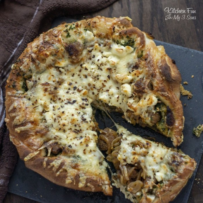 Pesto Pizza with sausage and kale is a delicious homemade pizza recipe. You can make this for lunch, dinner or make a couple as a great appetizer at a party!