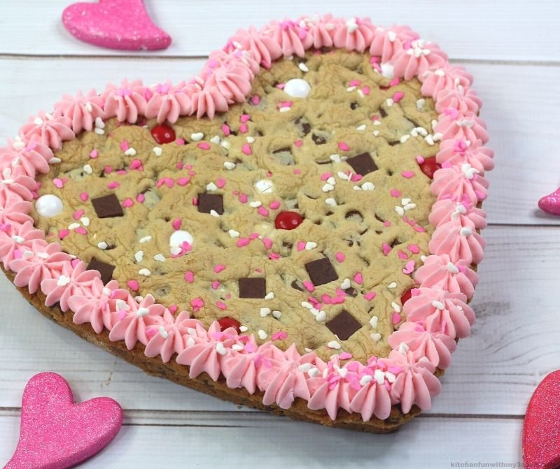 cookie heart cake with candies and sprinkles