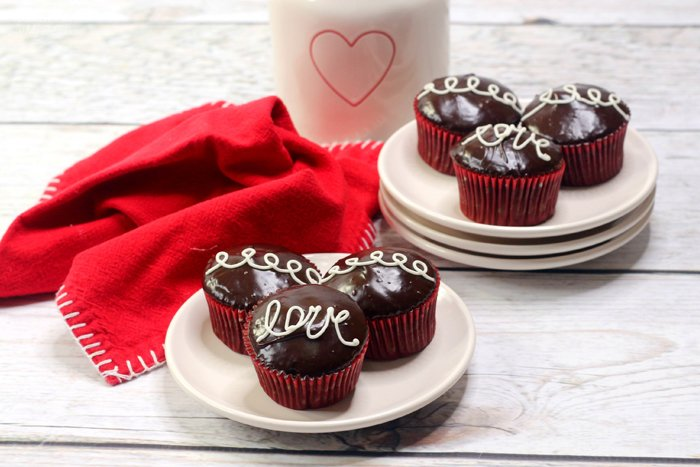 Homemade Hostess Cupcakes for Valentine's Day are a delicious treat for the holiday. These are so much like the original: chocolate cupcakes filled with yummy cream and topped with chocolate.