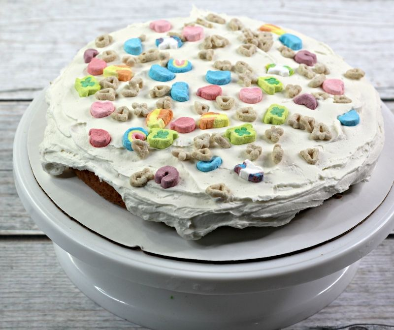 cake layer with frosting and cereal