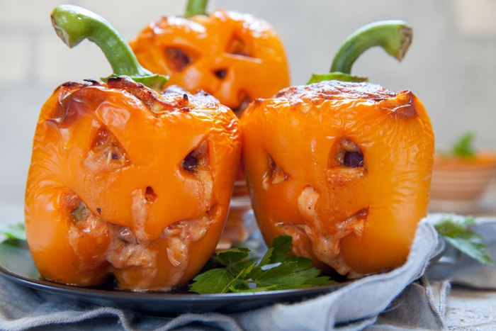 These Spooky Stuffed Peppers are the most fun and filling Halloween dinner. They are fresh bell peppers filled with a simple ground turkey and rice recipe.
