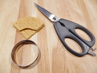 Using A Cookie Cutter To Cut The Graham Cracker