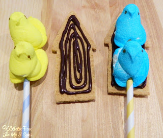 Chocolate Being Used to Hold The Graham Cracker and the Peeps Together