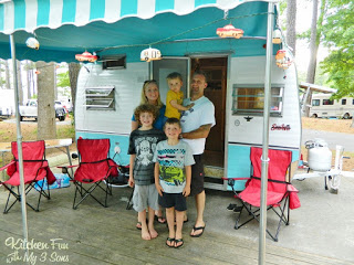 Here we all are with our cute little restored camper