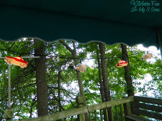 our lights on the awning. Little vintage cars & campers
