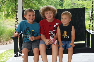 Here are my boys on the front porch swing of Elvis' home he grew up in