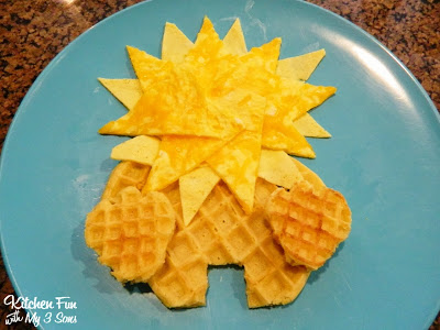 Cut the shape of feet with 2 of the Eggo minis using kitchen scissors & place on to sides