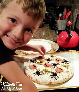 Here is my 7 year old making this fun Spider Pizza