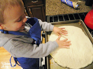 roll out your Pillsbury pizza dough onto a lightly greased pan