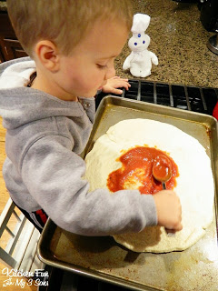 Then spread on the pizza sauce