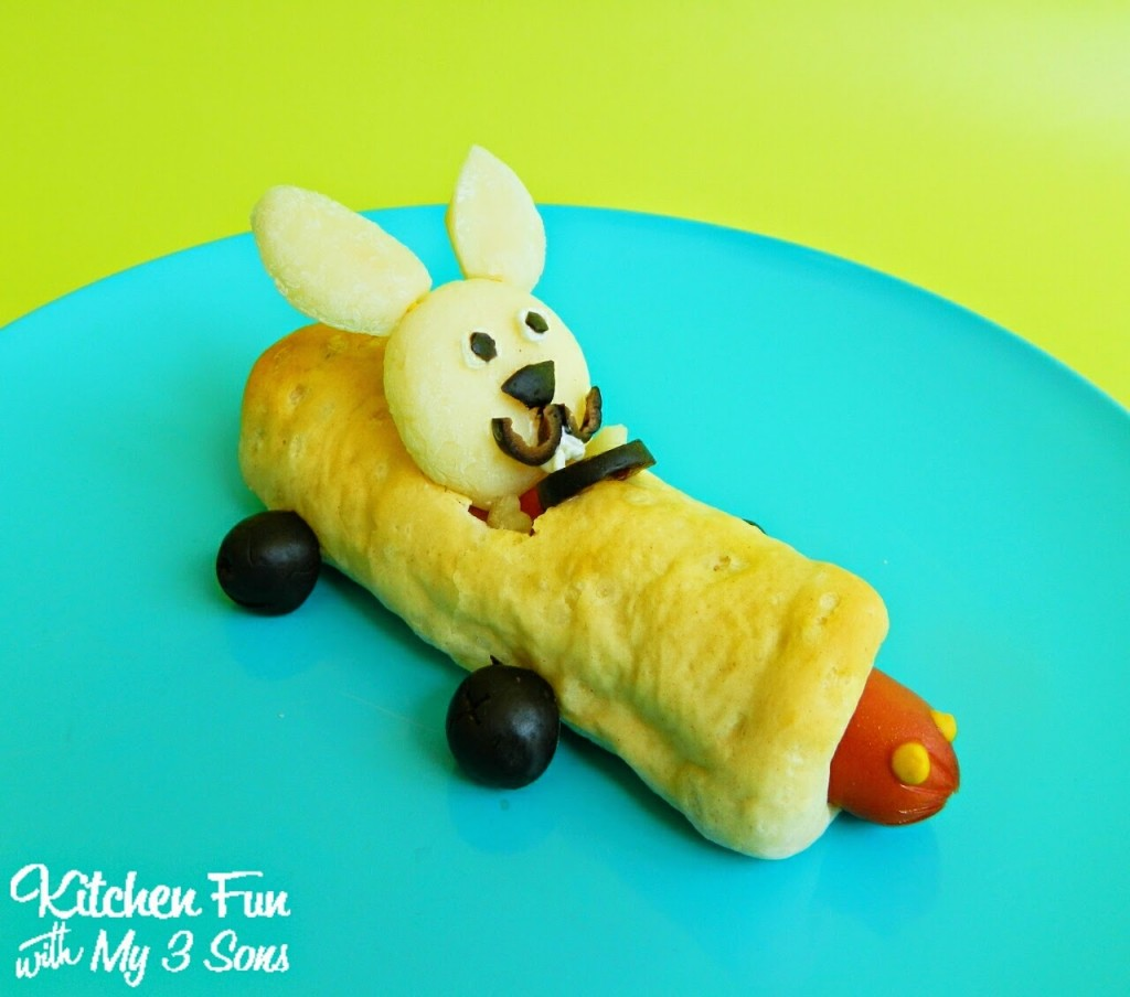 Babybel Bunny riding a Pig in a Blanket Race Car