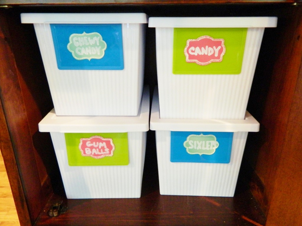 In the lower part of the top cabinet we keep containers of different candy.