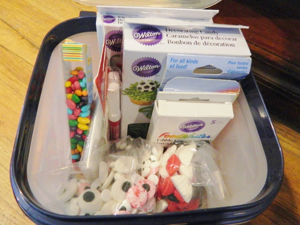 In this container we keep colored sunflower seeds, edible markers, edible eyes, & other misc. candy