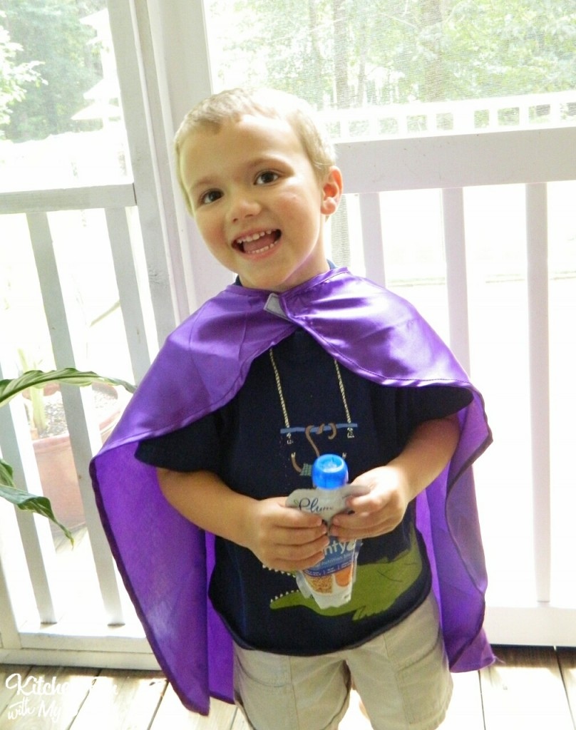 Here is my little Mighty Tot with his Plum Organics fruit & veggie pouch