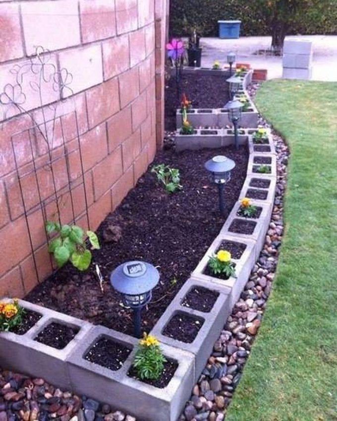 use cinder blocks for edging around a garden flower bedthese are the - Garden Ideas Using Tyres