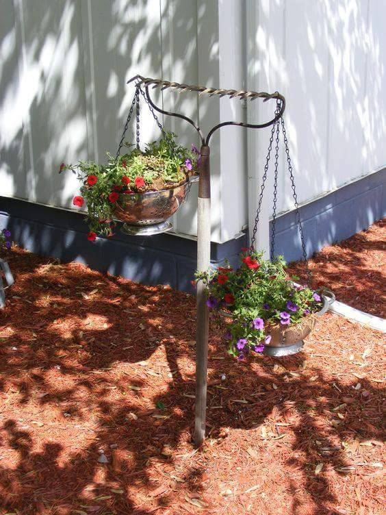 Use a RAKE to hold POTTED FLOWERS....these are awesome Garden & DIY Yard Ideas!