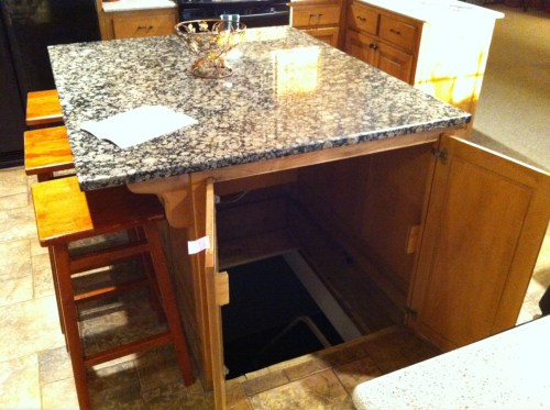 Under the Kitchen Table Storm Shelter or Storage Room!