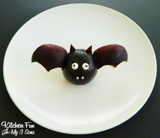 Halloween Fruit Bat...this adorable idea is so easy to make using a Plum & the Kids will Love this!