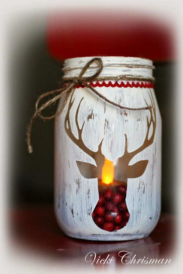 holiday stenciled deer jarthese are the best christmas mason jar ideas