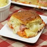 These Hawaiian pizza sliders recipe is one of my favorite easy dinners with chunks of ham and pineapple on sweet rolls.