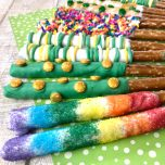 These St Patrick's Day Pretzel Rods are a really fun treat to celebrate the holiday. Coat pretzels in candy melts and decorate with fun sprinkles and sugars. So easy!