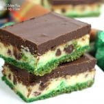 Bailey's Cheesecake Bars are a yummy combination of cheesecake and chocolate ganache on a graham cracker crust. Perfect St. Patty's Day dessert!