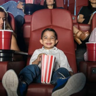 Kids Can Get A Movie Ticket, Popcorn, Drink And Snack For $4 At AMC Theatres This Summer