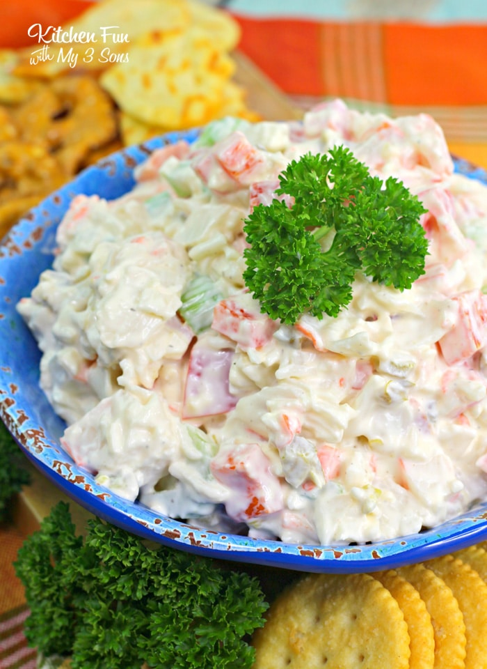 This Crab Dip recipe has a kick of spicy jalapenos, bell peppers and siracha. This is a great recipe to take to your next pot-luck!