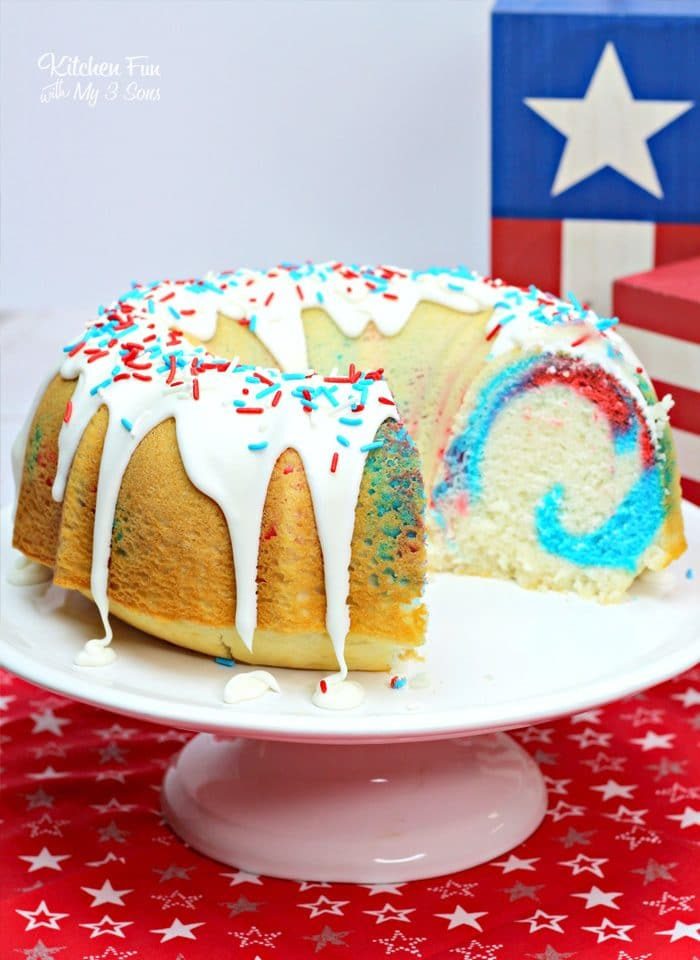 Dazzle your 4th of July guests with a Fireworks Bundt Cake that has a sweet red, white and blue center and is all decked out for the celebration.
