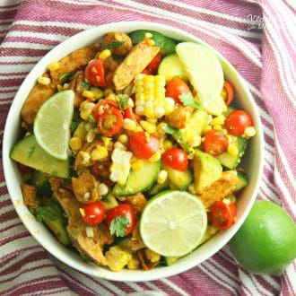 Cajun Lime Chicken Avocado Salad with corn and tangy cilantro lime dressing will knock your socks off. This is a a delicious summer salad.