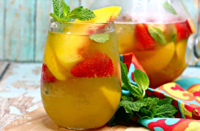 This Peach Sangria recipe is the best around. With white whine, peach nectar and frozen peaches, this will quickly become your favorite summer drink recipe.